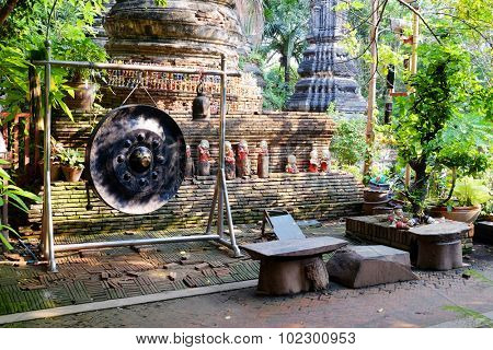 Ancient gong and bells in Buddhist temple in Ayutthaya Historical Park Thailand