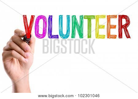 Hand with marker writing: Volunteer