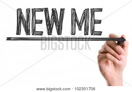 Hand with marker writing: New Me