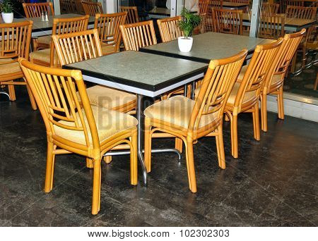 glass table and wooden chairs