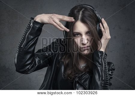 Young Woman With Head Phones Listening To Music