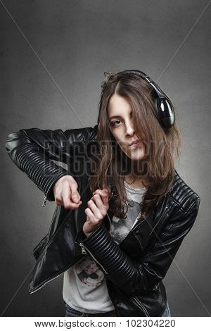 Woman Dancing While Listening To Music With Headphones
