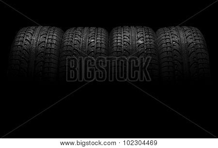Car Tires Over Black Background