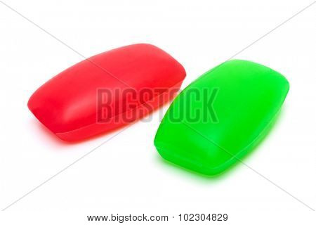 two pieces of soap on a white background