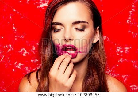 Sexy Girl Rubbing Lipstick And Closing Eyes