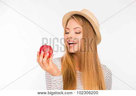 Cute Girl With Hat Looking At The Apple With Appetite