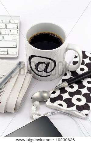 Coffee In White Cup With At Symbol