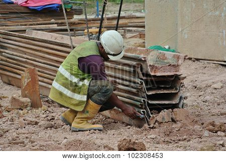 Construction workers inspecting the sheet pile