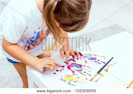 Little Beautiful Girl Draws Paints.
