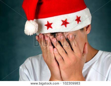 Sad Teenager In Santa Hat