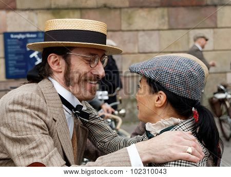 Smiling Man In Straw Hat Hugging Elegant Lady Wearing Old Fashioned Clothes