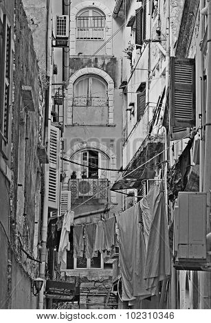 Greece. Corfu Island. A Typical Courtyard In The Center Of Corfu Town. In Black And White