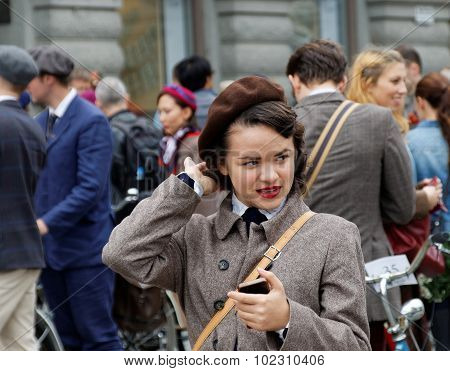 Girl Wearing Old Fashioned Tweed Clothes Fixing The Hat