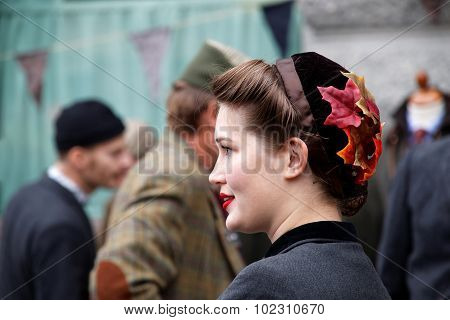Smiling Girl In Profile Wearing Old Fashioned Tweed Clothes