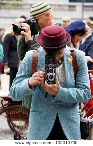 Photographer With Retro Camera Wearing Old Fashioned Clothes