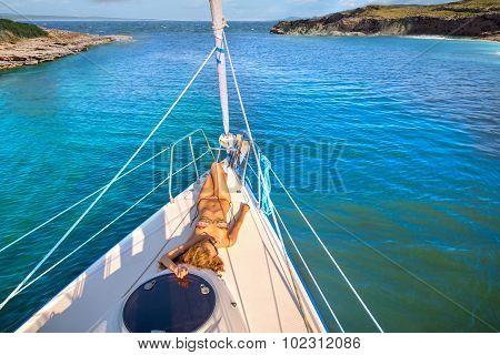 Beautiful girl sunbathing on the yacht.