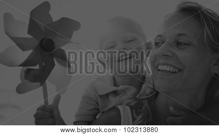 Mother Son Windmill Sea Vacation Holiday Piggyback Concept