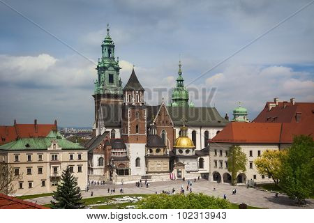 Krakow Wawel castle towers roof view with tourists, Poland, Europe