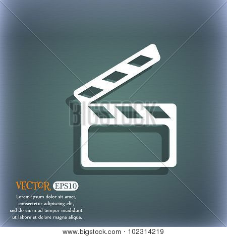 Cinema Clapper  Sign Icon. Video Camera Symbol. On The Blue-green Abstract Background With Shadow An