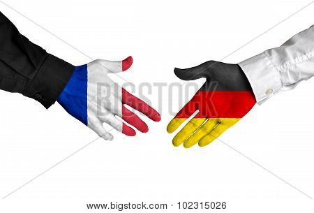France and Germany leaders shaking hands on a deal agreement