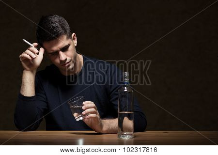 Businessman Drinking Alcohol After Work