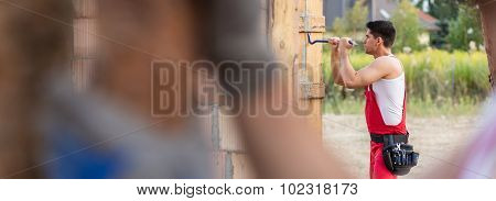 Man Working On Home Construction