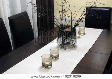Vase and candles on the table.