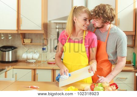 Couple Cooking In Kitchen, Preparing Meal