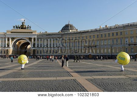 ST. PETERSBURG, RUSSIA - SEPTEMBER 12, 2015: Promoters in tennis ball's costumes entertain people on the Palace square during City's Tennis Day and international tennis tournament St. Petersburg Open