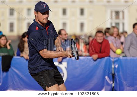 ST. PETERSBURG, RUSSIA - SEPTEMBER 12, 2015: Professional ice hockey player Alexey Ponikarovsky in the exhibition match of International tennis tournament St. Petersburg Open during City's Tennis Day