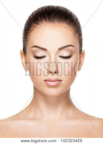 Beautiful face of young caucasian woman with health fresh skin  - isolated on white.  Closed eyes