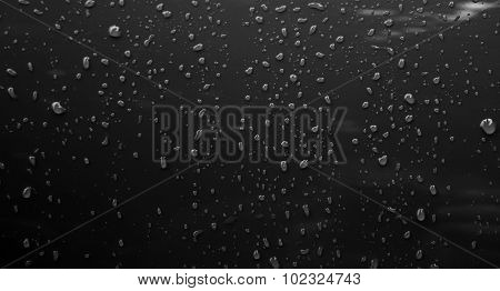 Rain drops on metal surface after water repellent coating