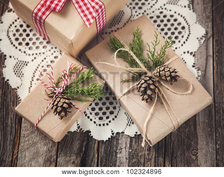 Hand crafted gift on rustic wooden background, toned image