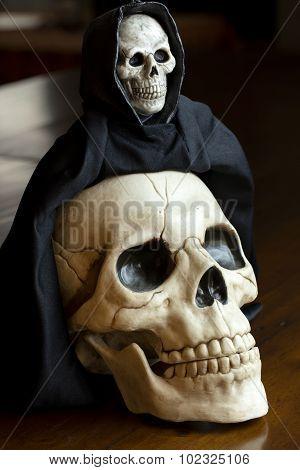 Skull And Grim Reaper