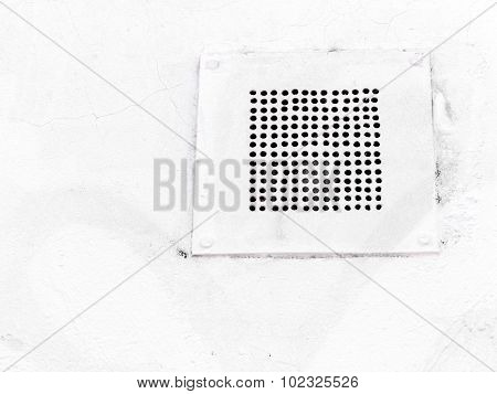 Ventilation Grille On The Plastered Wall With Cracks And Scratches