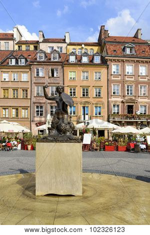 WARSAW, POLAND - SEPTEMBER 16, 2015: Statue of Mermaid at Old Town Market Place on 16 September 2015 in Warsaw, Poland. Mermaid made by the sculptor Konstanty Hegel is the symbol of Warsaw.