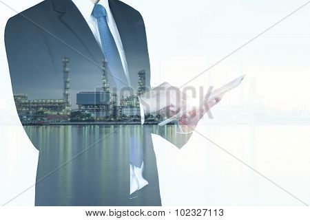 Double Exposure Of Businessman With Oil Refinery Industry