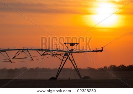 Irrigation Pivot On The Wheat Field At Summer Sunrise