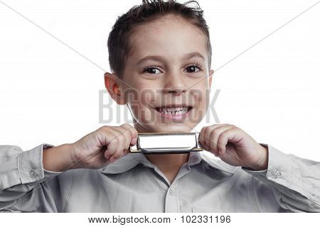 Smiling Child Showing A Harmonica In His Hands