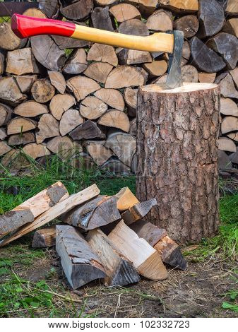 Axe on chopping block with chopped logs