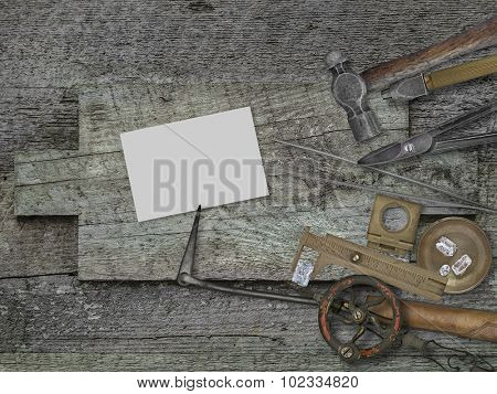 vintage jeweler tools and diamonds over wooden bench, blank card for your business