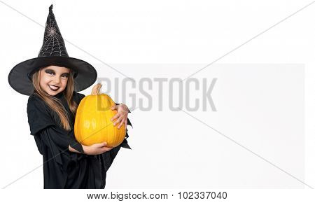 Little girl wearing halloween costume with pumpkin and blank board on white background