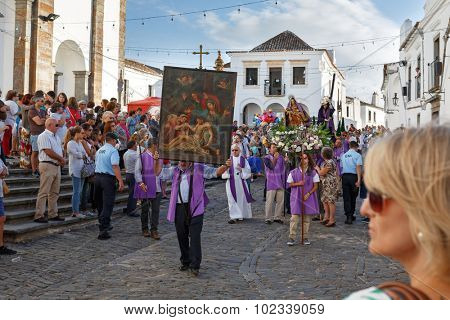 MONSARAZ, PORTUGAL - SEPTEMBER 13, 2015: Old religious christian procession during traditional festival in main square of the medieval village, Monsaraz, Alentejo