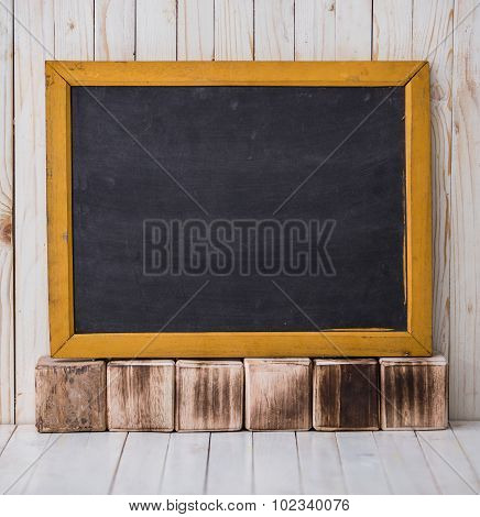 Black Chalkboard On Wooden Background, Horizontally Placed