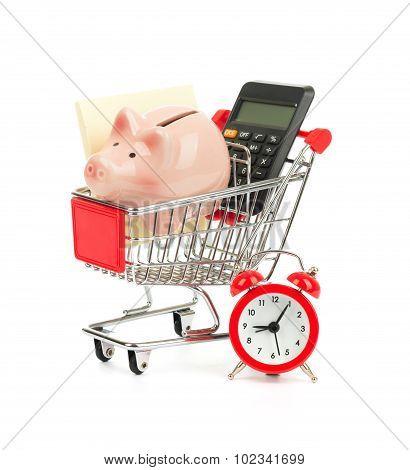 Piggy bank, calculator in shopping cart