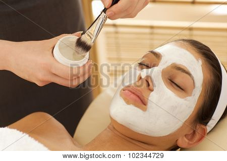 Close-up of young woman with facial mask