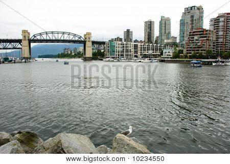 Burrard Bridge And Buildings In Vancouver