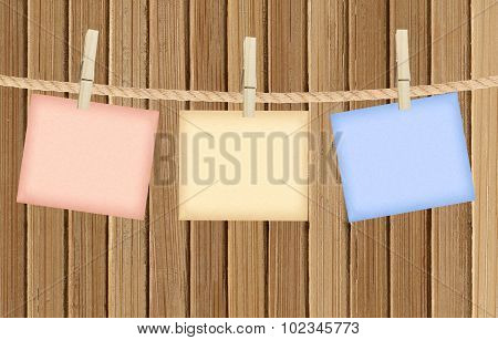 Reminder With Clothes Peg Over Wooden Background