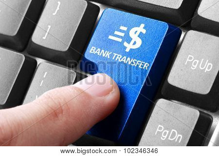Hand Press Bank Transfer Button On Keyboard