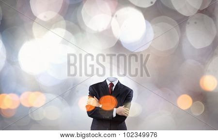 Faceless businessman with heart instead of head
